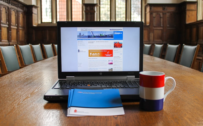 Website Shown on a Laptop With a Coffee Mug