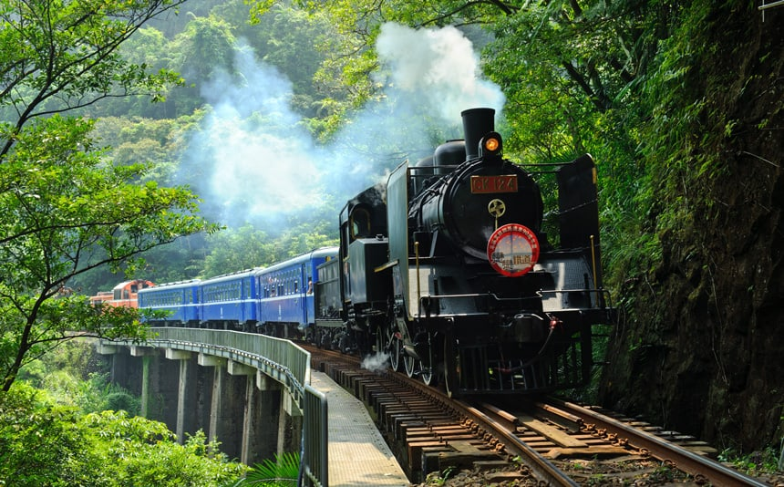 Locomotive on tracks moving forward